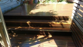 A very old hardwood deck in Austinmere with a few repaired boards and finished with Sikkens.