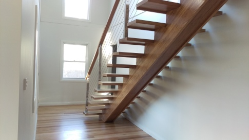 Stairs and floor coated with a water based polyurethane