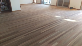 Hardwood floor stripped back and ready to coat