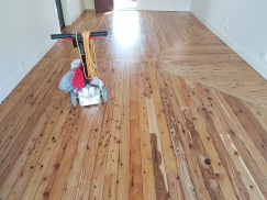 Very old cypress floor with a new patch-up getting ready for the final coat of water based polyurethane